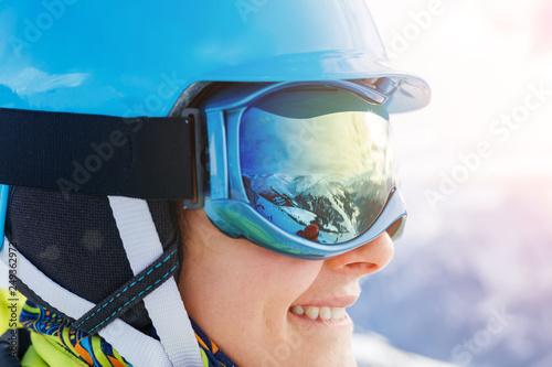 Stampa su Tela Closeup portrait of Girl snowboarder in the winter ski resort.