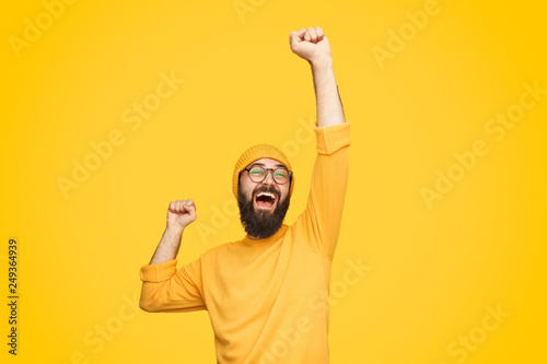 Fotografie, Obraz Excited bright man with fist up