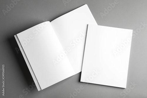 Obraz Open and closed blank brochures on grey background, top view. Mock up for design - fototapety do salonu