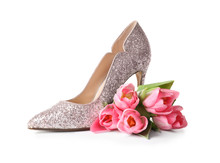 Stylish Lady's Shoe And Beautiful Spring Tulips On White Background. International Women's Day