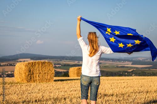 Fotografie, Obraz  Woman holding waving european union flag outdoors