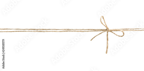 Foto Twine rope with bow isolated.