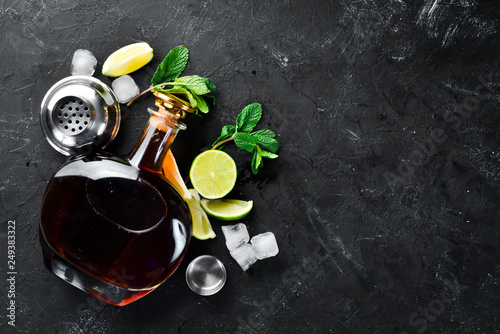 Alcoholic Beverage Rum, lime and mint on a black stone background Canvas Print