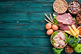 Fototapeta Fototapety do kuchni - Balanced diet food background. Protein foods On a blue wooden background. Free space for your text.