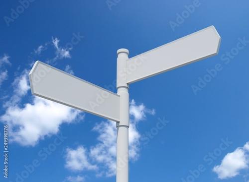 Fotografía  White blank signpost isolated on blue sky