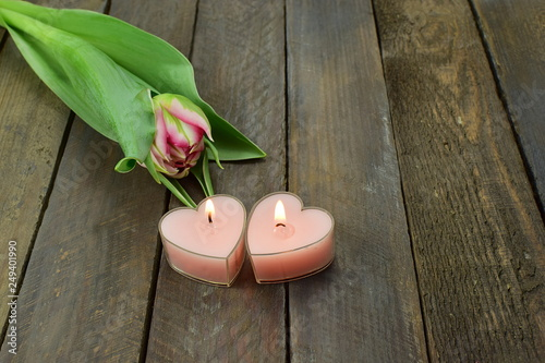 romantic background flower and  shape of hearts candles