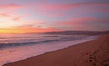 Pink Sunset Cloud Reflection Over Santa Clara River Seaside Marsh At Ventura Beach In California United States
