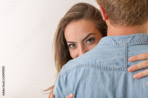 Girl with beautiful eyes hugs boy Canvas Print