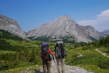 Two Hikers, Backpackers Admiring Tombstone Mountain In Kananaskis Country, Alberta