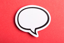Speech Bubble Isolated On Red Background