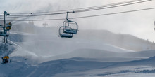 Snow Cloaked Mountain With Ski Lifts And Snow Guns