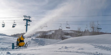 Snow Gun Against Ski Lifts And Cloudy Sky In Utah