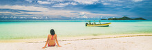 Luxury Paradise Getaway Beach In French Polynesia. Secluded Island Boat Tour In Tahiti, Woman Tourist Relaxing Sitting On Sand Looking At Turquoise Water Banner Panorama.