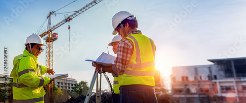 Construction engineers discussion with architects at construction site or building site of highrise building with Surveying for making contour plans is a graphical representation of the lay in land Tapéta, Fotótapéta