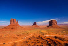 Monument Valley. Navajo Tribal Park. Red Rocks And Mountains. Located On The Arizona–Utah Border. USA
