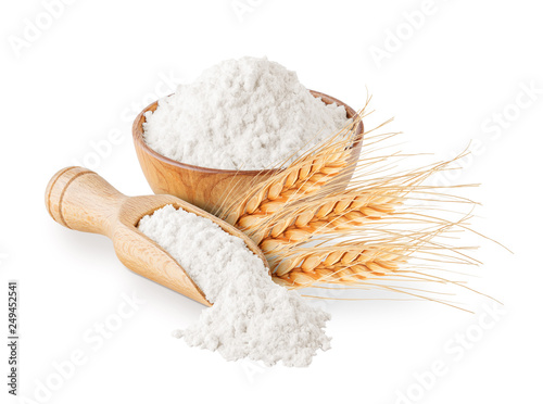 Vászonkép Whole grain wheat flour and ears isolated on white