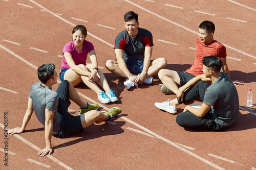 Fotografie, Obraz  young asian athletes relaxing after training