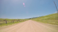 Car Driving On Rural Dirt Road In South Denver Near Chatfield State Park