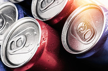 Red And Blue Cans Of Soft Drin...