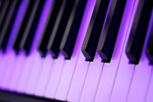 Piano Keyboard In Purple Light