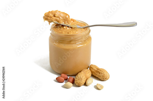 Cuadros en Lienzo Peanut butter in a glass jar and a whole peanut isolated on white background