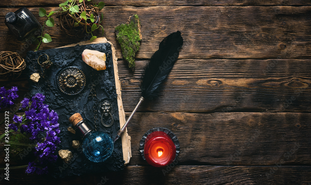 Fototapety, obrazy: Spell book, magic potions and other various witchcraft accessories on the wizard table background with copy space.