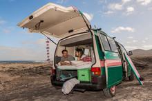 Couple In Trunk Of Caravan