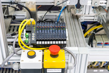 Close Up Emergency Stop Switch And Ethernet Sensor Communication Unit With Fiber Optic Cable Of High Performance Automatic Manufacturing Assembly And Inspection Process At Production Line