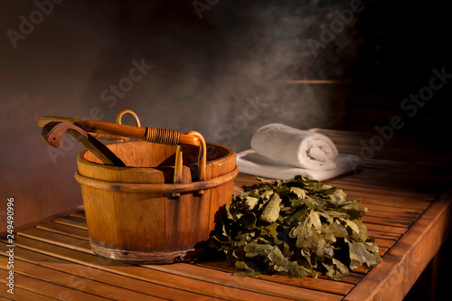Cuadros en Lienzo wooden bucket and couch in the Russian bath. darkened interior