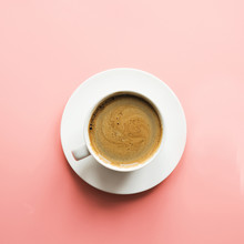 Cup Of Black Coffee On Pink Background. Isolated. Top View.