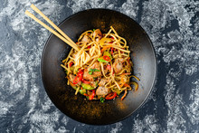 Udon Stir-fry Noodles With Chicken Meat And Sesame In Bowl