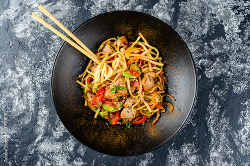 Udon stir-fry noodles with chicken meat and sesame in bowl Canvas Print