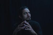 Portrait Of Man Meditating In ...