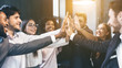 canvas print picture - Happy multiracial business team giving high fives