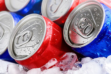 Red And Blue Soda Cans On Ice ...