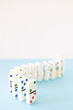 White Dominos With Brightly Co...