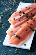 Slices Of Raw Trout On A White Plate