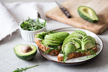 Healthy Breakfast With Avocado And Delicious Wholewheat Toast. Sliced Avocado On Toast Bread With Spices. Mexican Cuisine