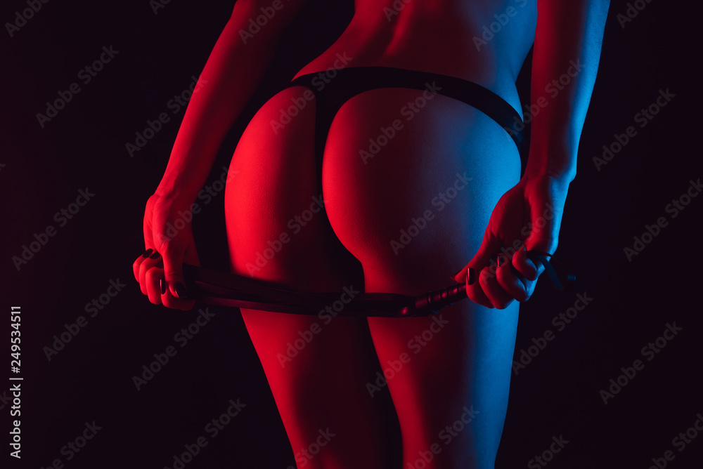 Fototapety, obrazy: Sexy erotic ass of a girl in a Thong with a whip for BDSM