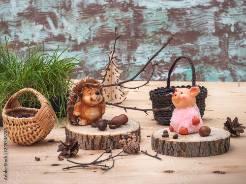 Fotografie, Obraz  A fabulous picture with small toys, a Hedgehog and a pink pig are resting on stu