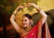 Leinwanddruck Bild - Female dancer dressed in traditional Indian clothing