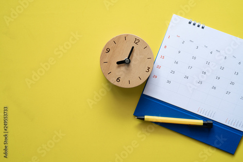 Fényképezés  close up of calendar, clock and pen on the yellow table, planning for business m