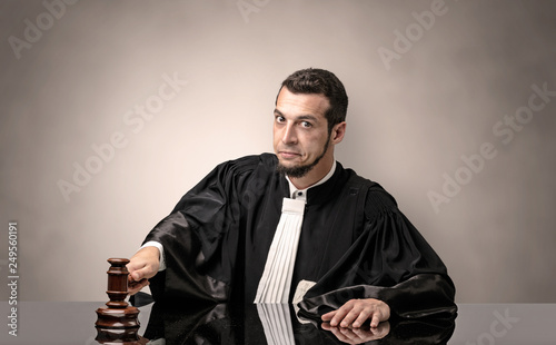 Canvas Print Young dashing judge in black gown making decision with no concept