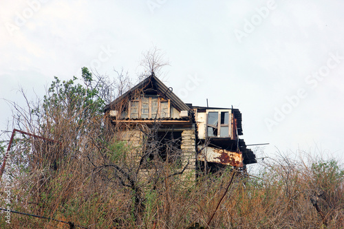 abandoned dilapidated old shack house of poor man made of all kind garbage Fototapet