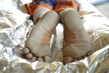 Selective Focus On Dirty Bare Feet Of Boy After Playing. Poverty Concept.