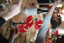 Women Make Floral Arrangements...