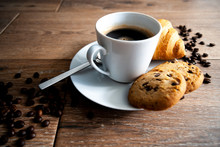 Coffee In White Mug With Cookies And Croissant