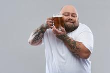 Waist Up Of Bearded Tattooed M...