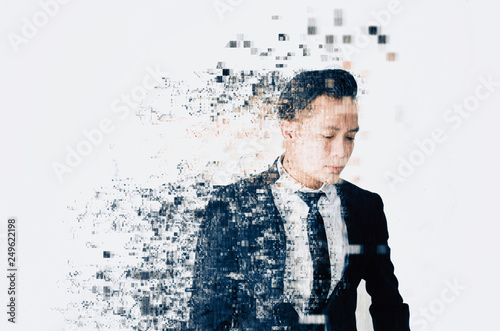 Photo young businessman with dispersing and disintegrating into particles effect over