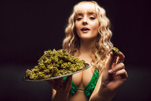 Blonde Caucasian Woman In Cannabis Bikini Poses With Tray Of Marijuana Buds